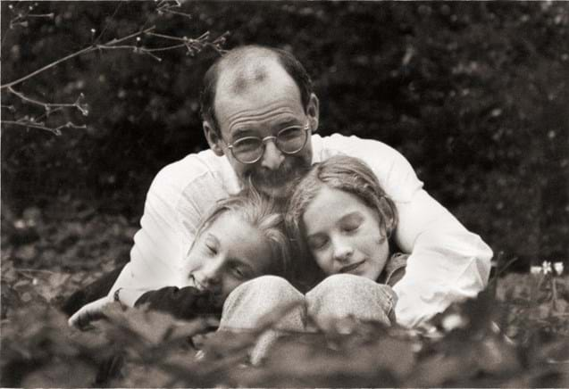 Father and twin daughters